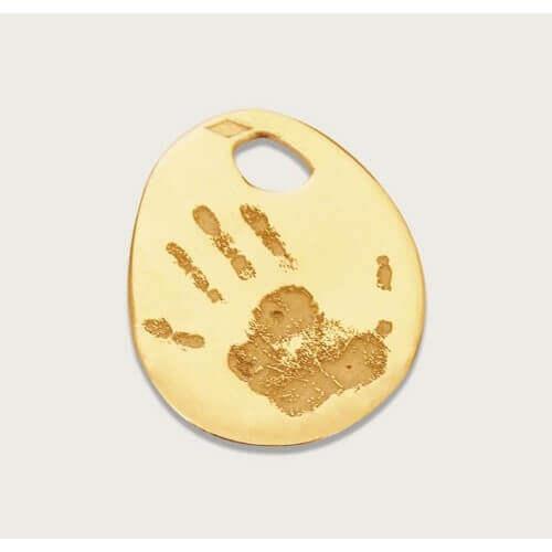 Les Empreintes : pendentif mini galet or jaune sur cordon