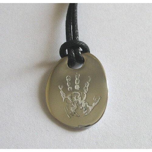 Les Empreintes : pendentif mini galet or blanc sur cordon